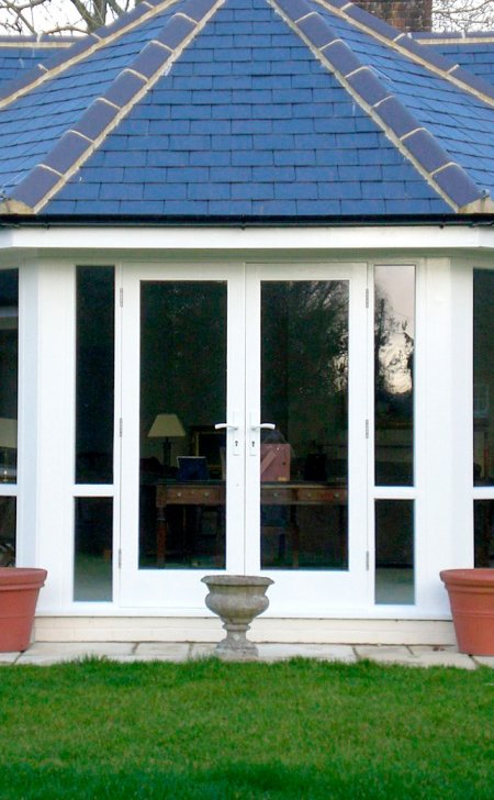 Pair of hardwood doors set within window sections.