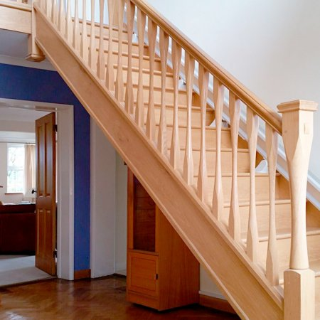 Oak staircase with modern style turned newel posts and spindles