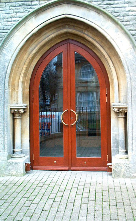 Pair of gothic shaped church doors & frame.