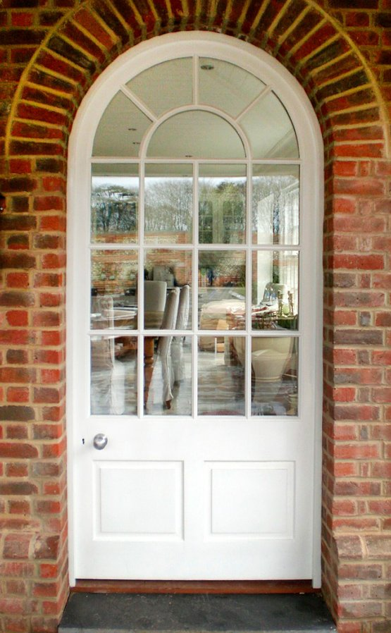 Hardwood painted door & frame, semi-circular headed