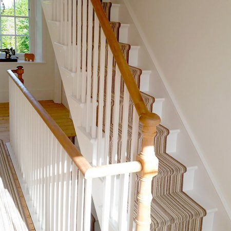 Special turned newel posts on a loft staircase that matches the old existing staircase below