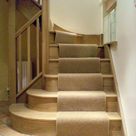 Oak staircase with three bullnose bottom treads to open out into the hallway