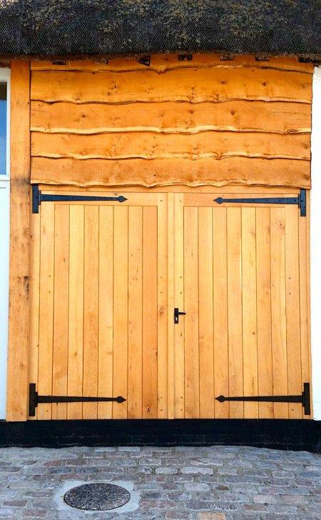 Pair of oak garage doors & frame.