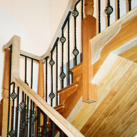 Oak cut string style staircase with metal spindles