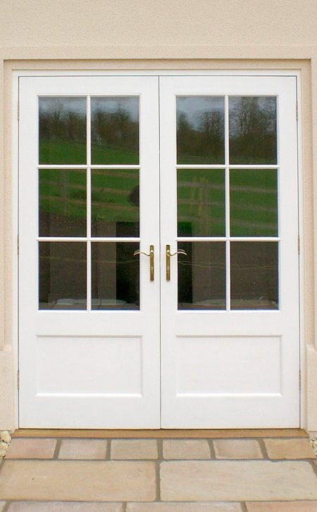 Pair of painted hardwood doors and frame.