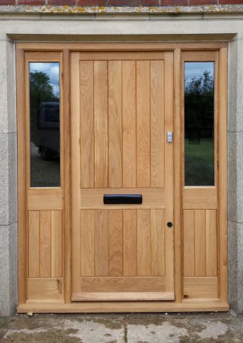 Oak door and frame with side lights.