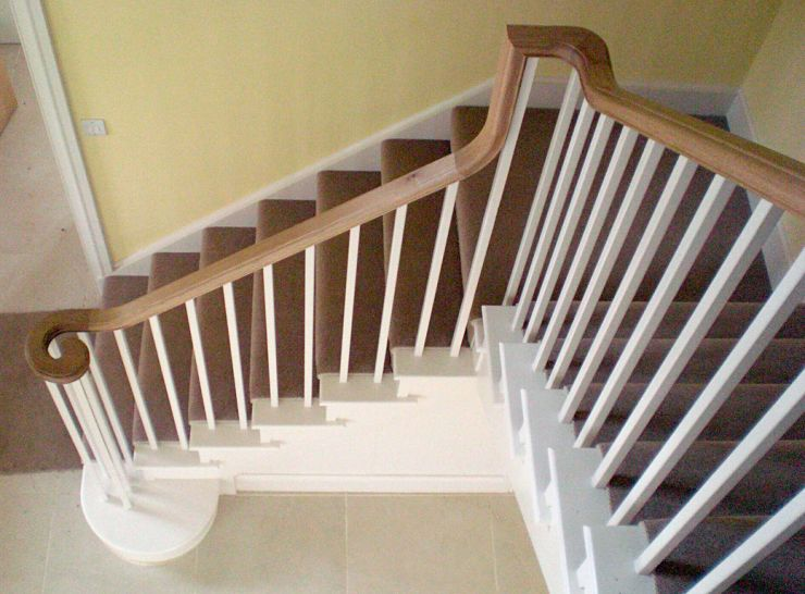 Painted staircase with oak continuous handrail